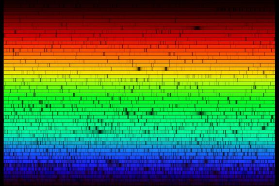 The solar spectrum -- both artificial and real -- as reconstructed by the Fourier Transform Spectrometer (FTS). The artificial part is that the FTS does not spread white light into the rainbow, but measures intensities. The real aspect is that this depicts these intensities as colors and shows the absorption lines -- fingerprints of atoms in the solar atmosphere -- that are too narrow for the human eye to perceive.