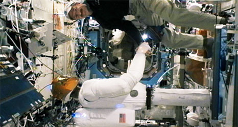 Greetings, Human! Space Robot Shakes Astronaut's Hand, Signs 'Hello'