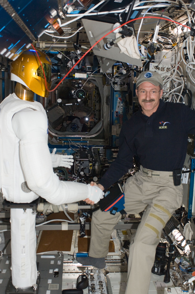 Space Robot Shakes Astronaut's Hand, Signs 'Hello'