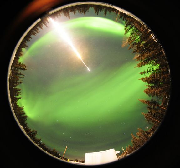 A fisheye photo taken by an automated camera near the entrance gate at the Poker Flat Research Range in Fairbanks, Ala., as a suborbital rocket launches into the northern lights on a science mission on Feb. 18, 2012.