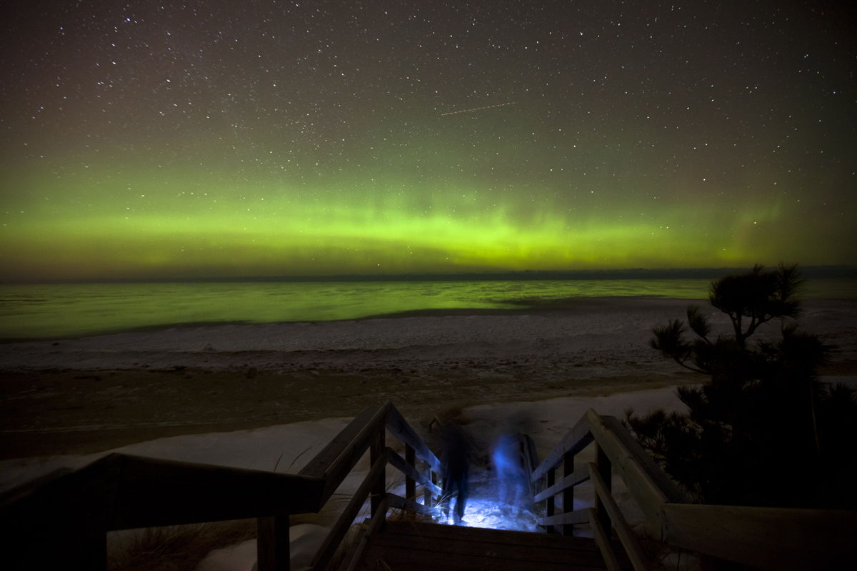 Aurora over Lake Superior with Couple
