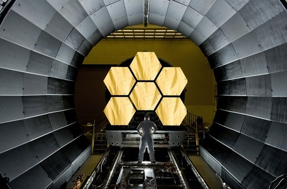 NASA engineer Ernie Wright looks on as the first six flight ready James Webb Space Telescope's primary mirror segments are prepped to begin final cryogenic testing at NASA's Marshall Space Flight Center.