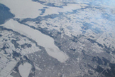 The snow-covered city of Barrie, Ontario, Canada, surrounds ice-bound Lake Simcoe in this view from NASA's DC-8 airborne science laboratory during a flight Feb. 20 in NASA's Global Precipitation Measurement Cold-season Precipitation Experiment, or GCPEx, mission