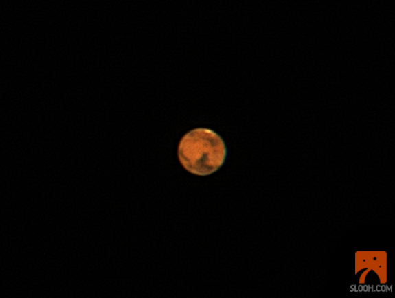 This still from a Slooh Space Camera webcast shows Mars as it appeared at opposition on March 3, 2012 at 11:30 p.m. ET (0430 GMT on March 4).