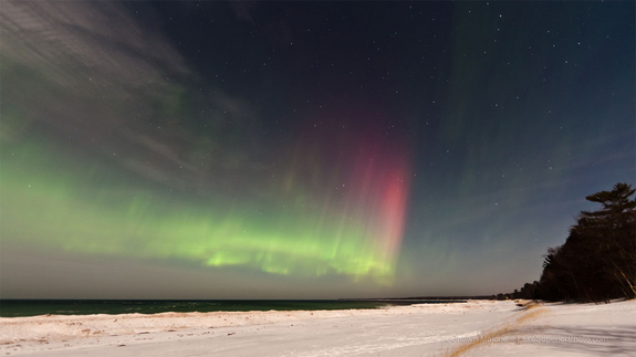 "Skywatcher Shawn Malone took this photo March 8, 2012. She writes: ""Caught a nice outburst of northern lights last night ... aurora over Lake Superior, Marquette, MI taken early this morning."""
