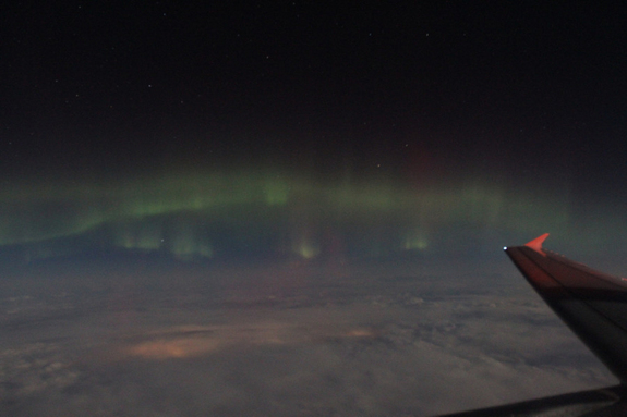 "Skywatchers Imelda B. Joson and Edwin L. Aguirre spotted the aurora on March 8, 2012, while travelling on a commercial flight. They write: ""We were on our way from Boston to Los Angeles at the time ... somewhere over Minnesota."""