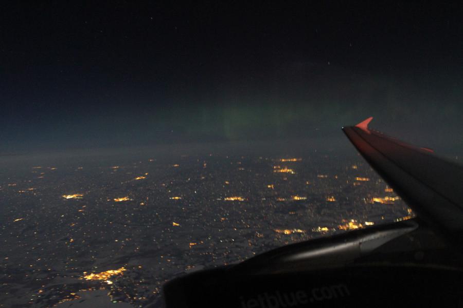 Aurora Viewed Through an Airplane Window