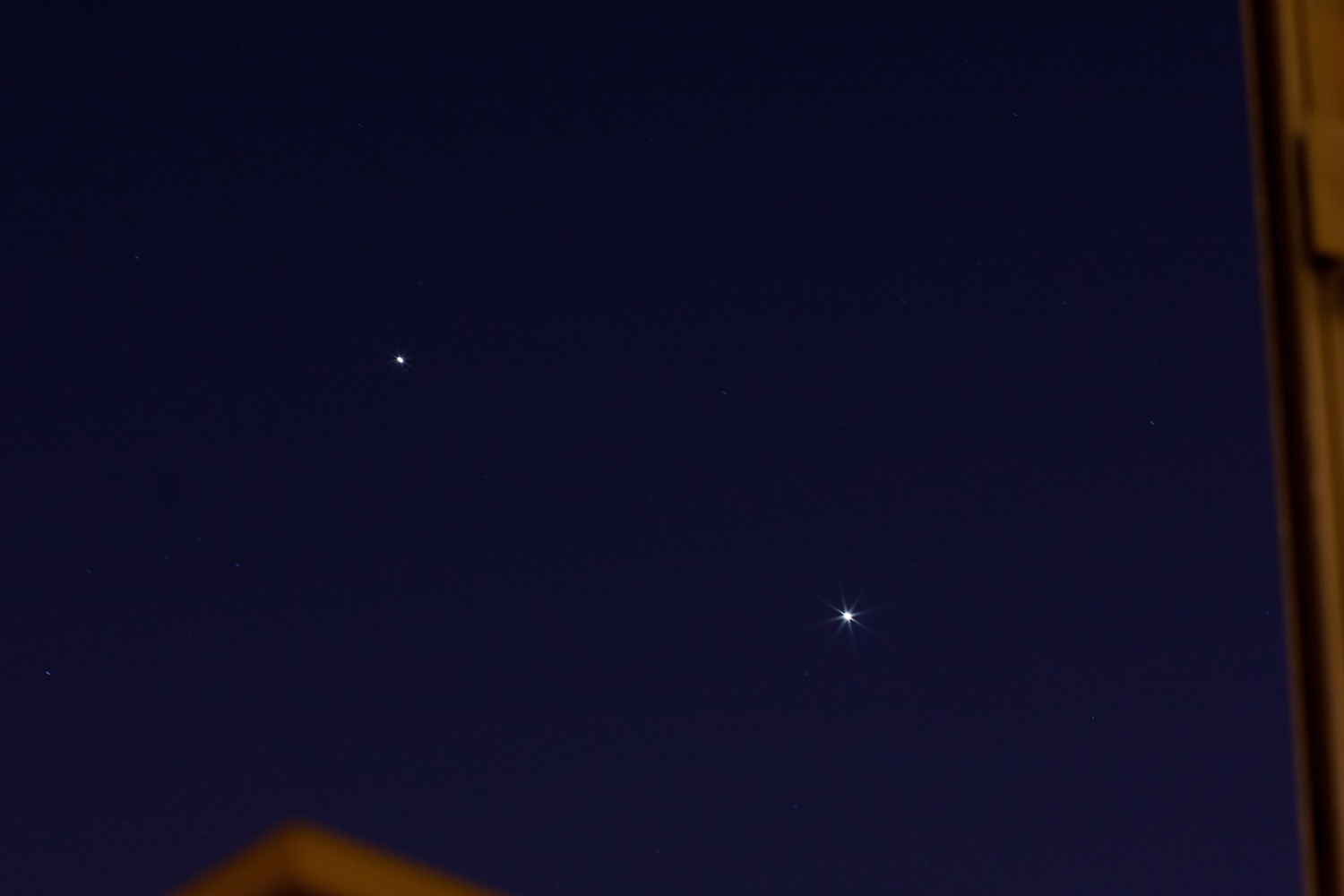 Jupiter and Venus Seen Through a Window