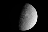 NASA's Cassini spacecraft took this raw, unprocessed image of Saturn's moon Rhea on March 10, 2012. The camera was pointing toward Rhea at 26,019 miles (41,873 kilometers) away.