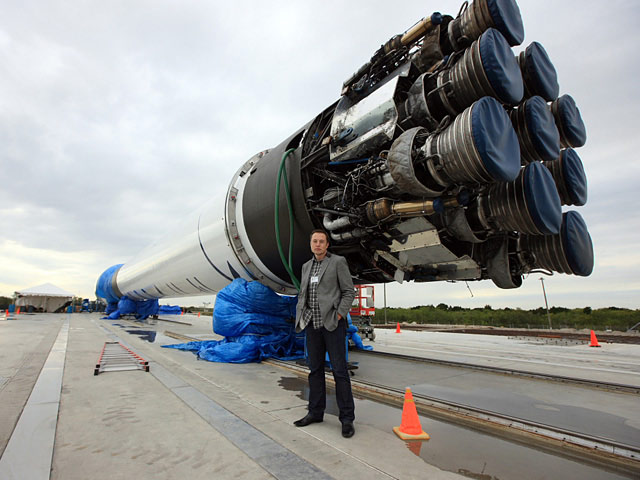 SpaceX CEO Elon Musk with Falcon 9 Rocket