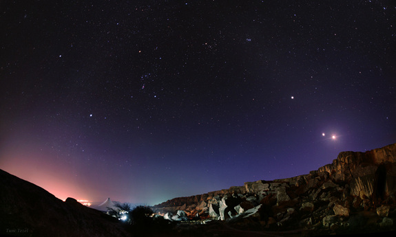 The moon and Venus are in conjunction in this image taken at Gobustan National Park in Azerbaijan, on Feb. 25, 2012.