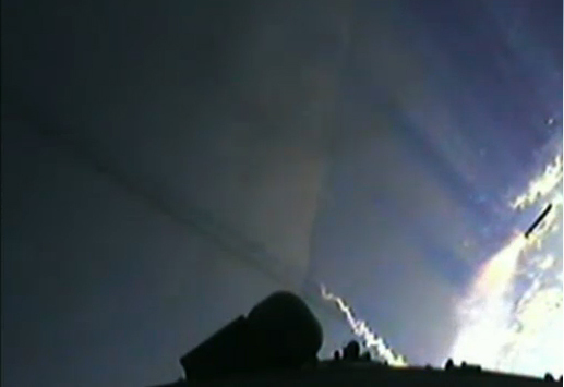 This view from an Ariane 5 rocket camera shows the rocket's boosters (one at far right) falling away after being jettisoned during a successful launch of the European ATV-3 cargo ship toward the International Space Station on March 23, 2012.