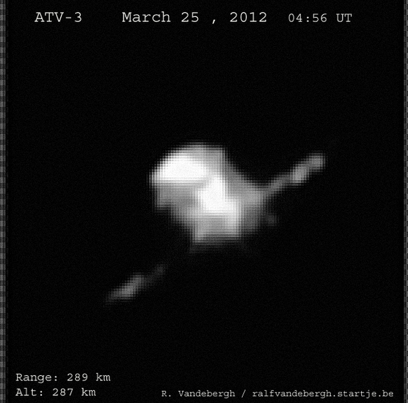 "Skywatcher Ralf Vandebergh sent this image of the ATV-3 spacecraft on its way to the International Space Station, taken March 25, 2012. He writes: "" ... solar panels visible from a low angle. Obtained using a 10inch reflector and manually tracking."""