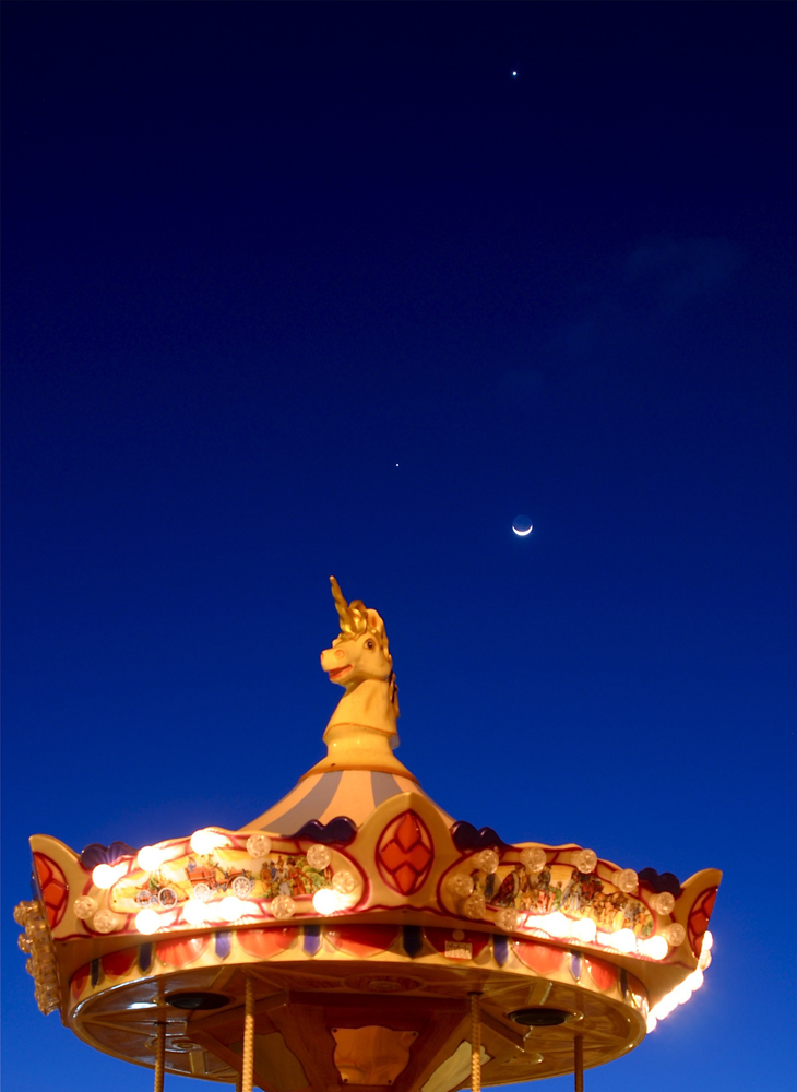 Jupiter, Venus and the Moon over a Carousel, Tenerife, Spain