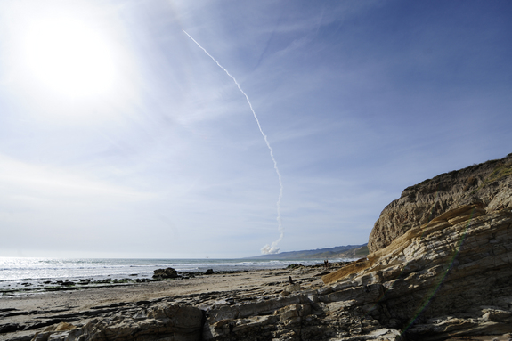 A United Launch Alliance Delta 4 rocket soars into orbit from Space Launch Complex-6 at Vandenberg Air Force Base in California at 4:12 p.m. PDT Tuesday, April 3, 2012. The rocket carried the NROL-25 spy satellite for the National Reconnaissance Office.
