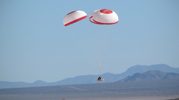 Boeing's CST-100 space capsule falls to Earth in a successful parachute drop test held April 3, 2012, at the Delamar Dry Lake Bed near Alamo, Nev.