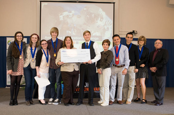 Each winning team at the Spirit of Innovation Challenge receives $5,000 to continue the development of their product. The four members of the Infinity team are on the left.