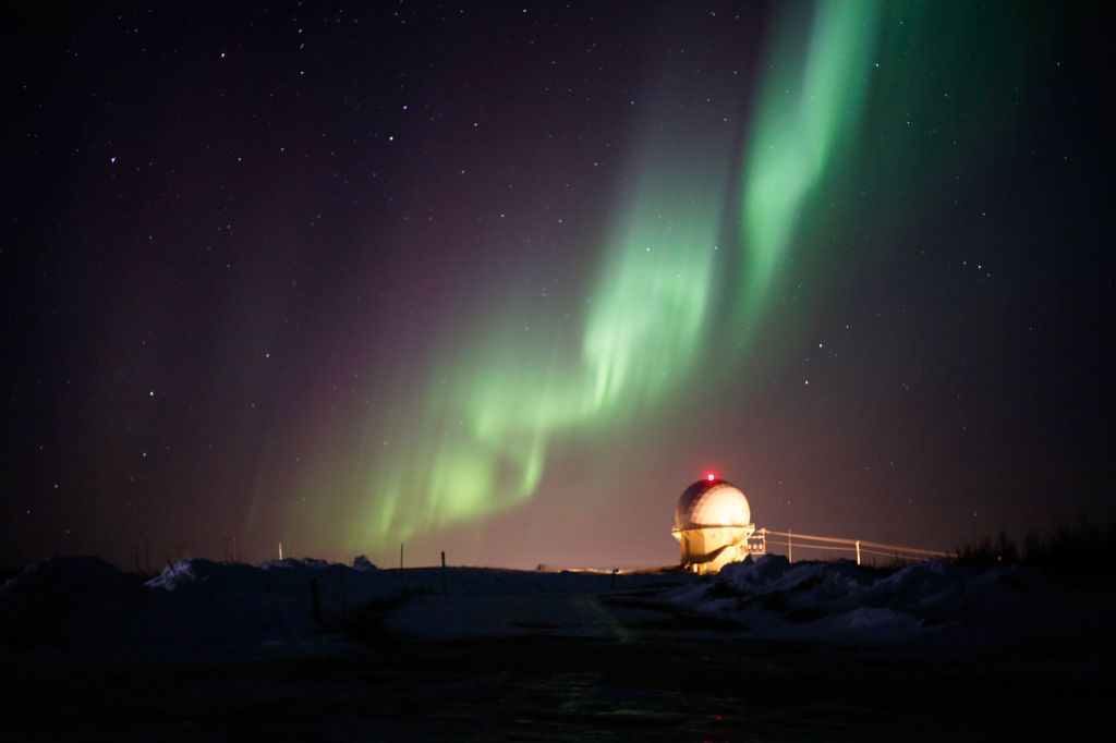 Alaska's Northern Lights Above a Radar Dome