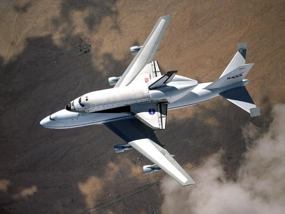 NASA space shuttle Columbia hitched a ride on a special 747 carrier aircraft for the flight from Palmdale, California, to Kennedy Space Center, Florida, on March 1, 2001.