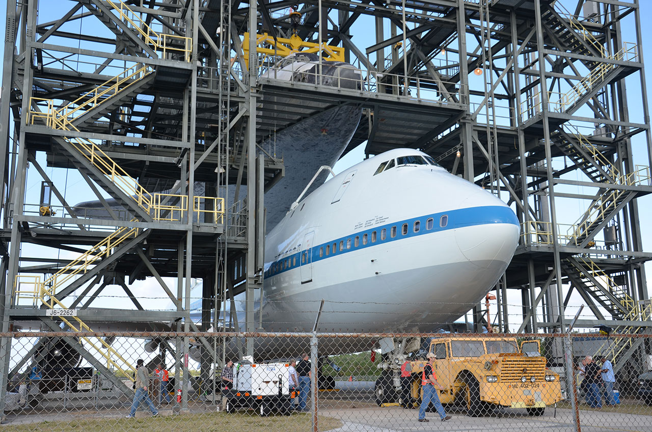 Space Shuttle Discovery Mounted Atop Jumbo Jet for Ride to Smithsonian