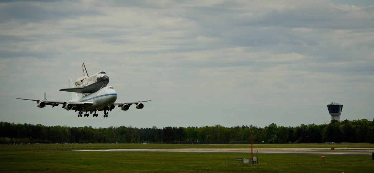 Shuttle Carrier Aircraft Carrying Discovery About to Land