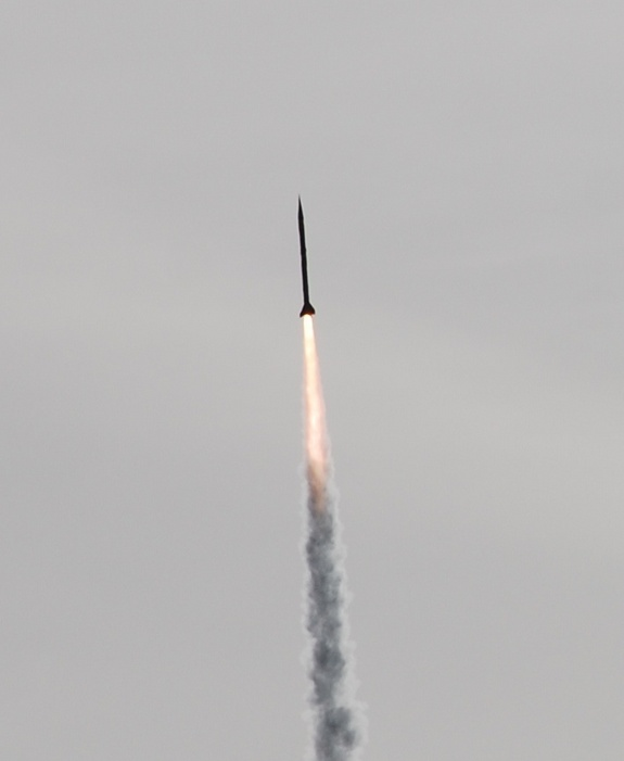 An UP Aerospace rocket speeds to a new altitude record over New Mexico's Spaceport America on April 5, 2012.