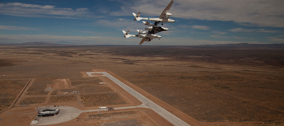 Virgin Galactic's high-flying WhiteKnightTwo mothership cradles SpaceShipTwo over New Mexico's Spaceport America.