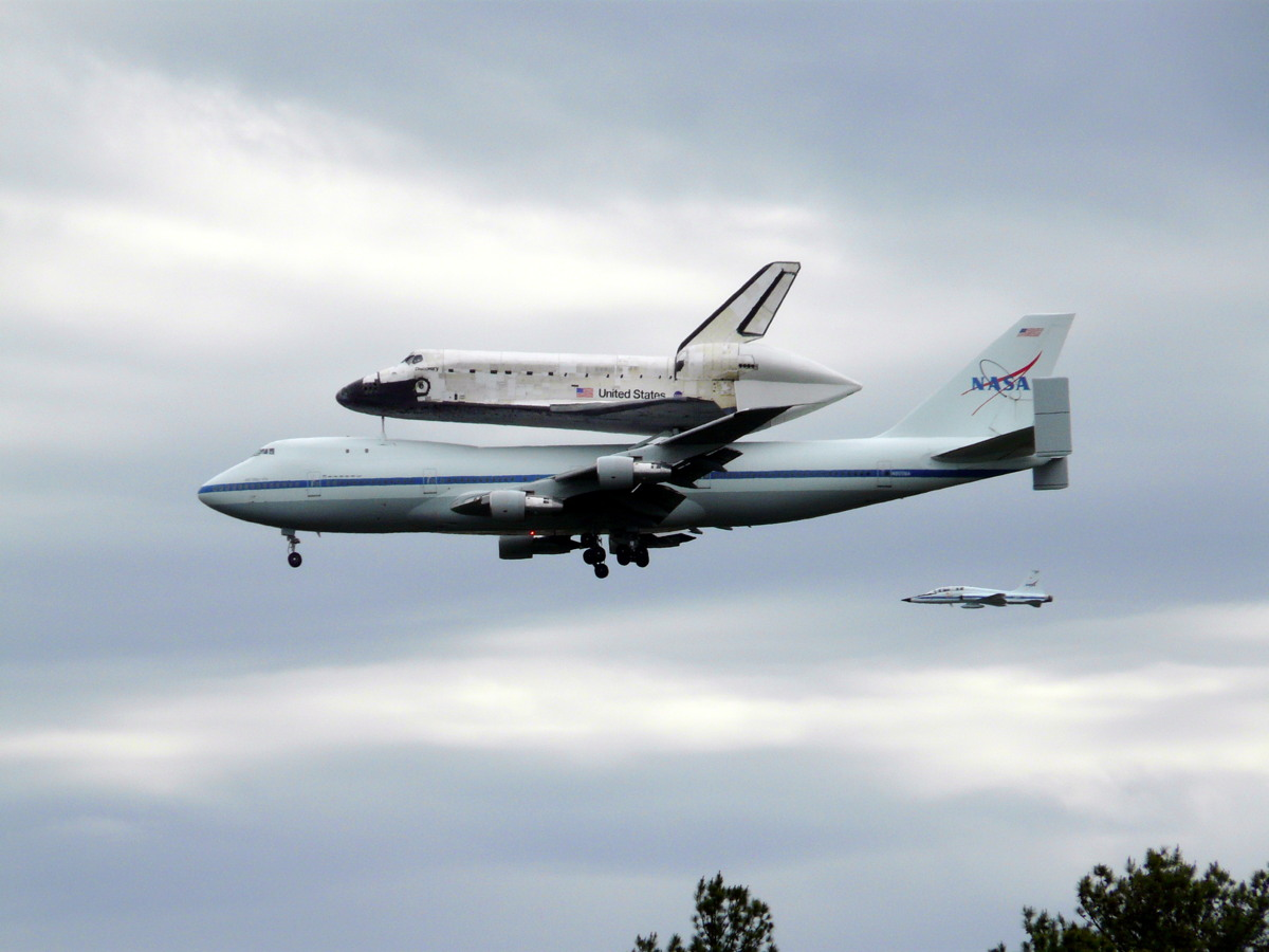 Shuttle Carrier Aircraft About to Land with Discovery