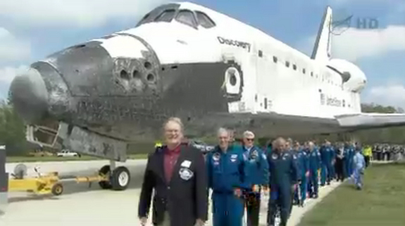 Veteran astronauts escort space shuttle Discovery to its new home at the Smithsonian's National Air and Space Museum annex on April 19, 2012. Discovery, NASA's oldest and most traveled shuttle, will be displayed at the museum's Steven F. Udvar-Hazy Center in Chantilly, Va.