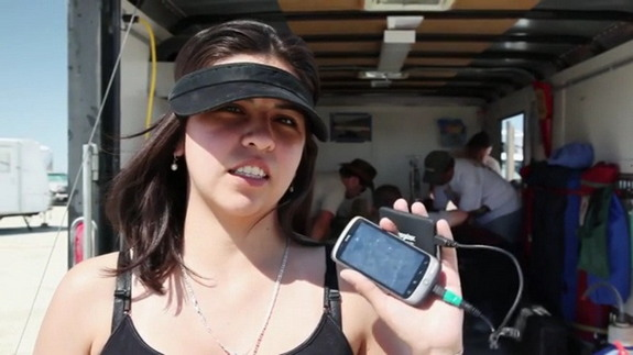 Carmen Felix of the PhoneSat Project holds up the smartphone flown during a rocket test.