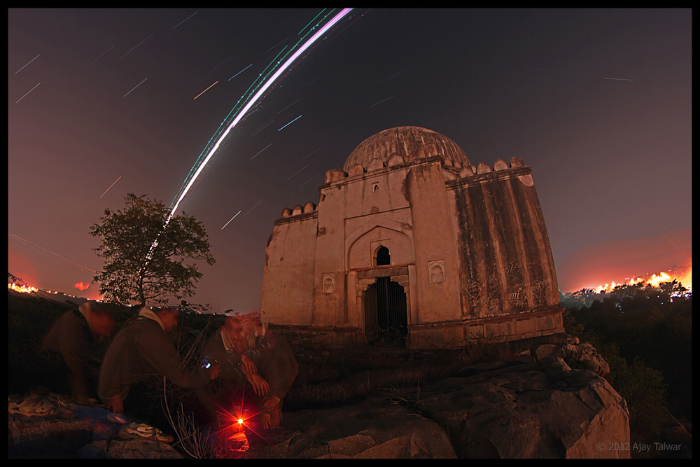 Skywatcher Photo Catches Star Trails & Plane Over Ancient Tomb