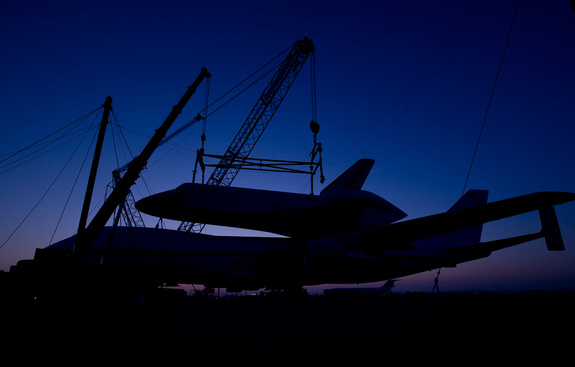 The prototype space shuttle Enterprise is seen in silhouette after it was mated on top of the NASA 747 Shuttle Carrier Aircraft (SCA) at Washington Dulles International Airport, Friday, April 20, 2012, in Sterling, Va. Enterprise will go on permanent display at the Intrepid Sea Air and Space Museum in New York in June.
