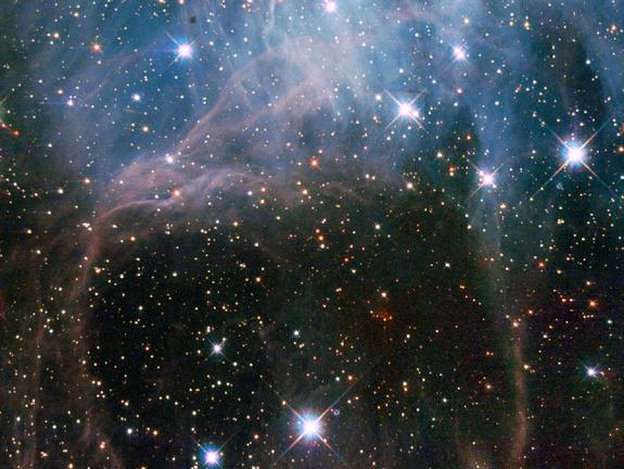 This image shows a young stellar grouping in one of the largest known star formation regions of the Large Magellanic Cloud, a dwarf satellite galaxy of the Milky Way. The picturesque view was captured by the Hubble Space Telescope's Wide Field Planetary Camera 2.