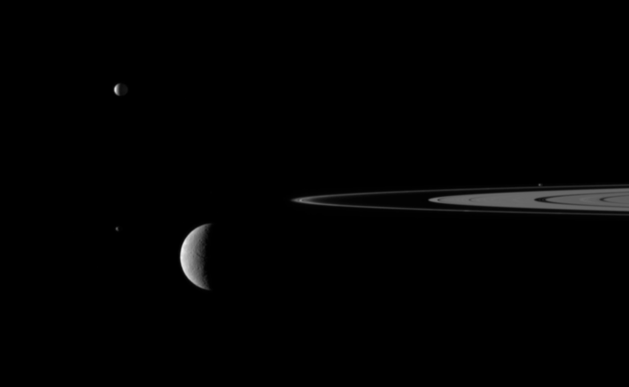 Saturn's Rings and Four Moons