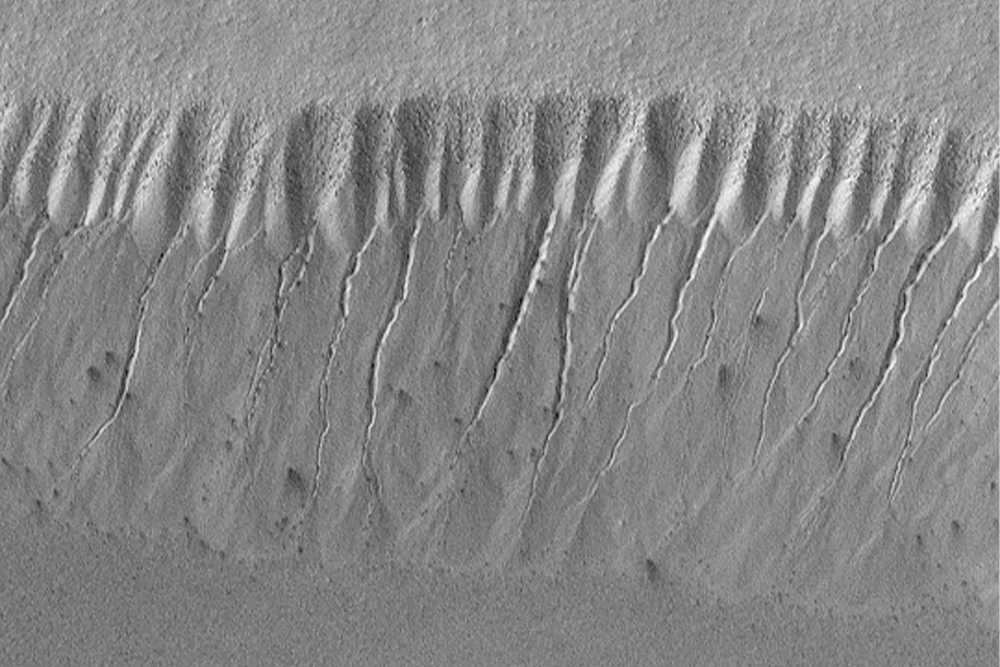 Space History Photo: Evidence for Recent Liquid Water on Mars: Gullies