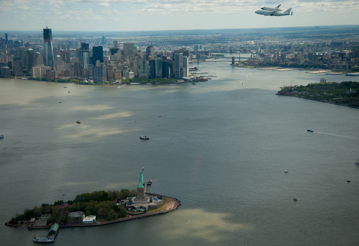 Enterprise Flies over the Statue of Liberty in New York Harbor
