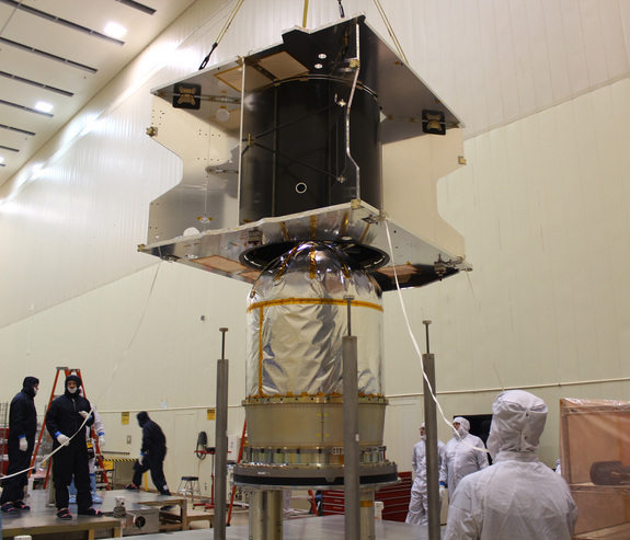 The MAVEN spacecraft's core structure is successfully lowered and attached to the hydrazine propulsion tank and boat tail assembly at Lockheed Martin's facilities in Colorado.