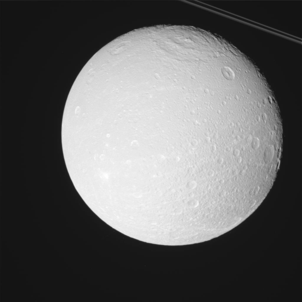 New Cassini Photos Show Saturn Moons Enceladus & Dione