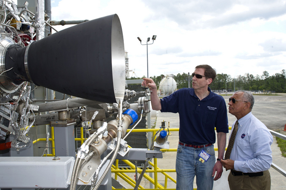 Steve Knowles, Blue Origin project manager (left) points out details of Blue Origin's BE-3 engine thrust chamber assembly to NASA Administrator Charles Bolden. The rocket gear is set for May testing on the E-1 Test Stand at NASA's Stennis Space Center in south Mississippi. The BE-3 will be used on Blue Origin's reusable launch vehicle as part of the agency's Commercial Crew Development Program. Blue Origin is one of NASA's partners developing innovative systems to reach low-Earth orbit.