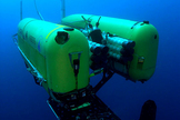 Underwater Nereus robot investigates hydrothermal vents along Earth's deepest mid-ocean ridge in the Cayman Trough. This unique vehicle can operate either as an autonomous, free-swimming robot for wide-area surveys, or as a tethered vehicle for close-up investigation and sampling of seafloor rocks and organisms.