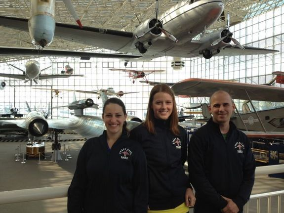The three remaining finalists in Space Race 2012 — from left, Sara Cook, Lauren Furgason and Gregory Schneider — pose at Seattle's Museum of Flight on May 8, 2012.
