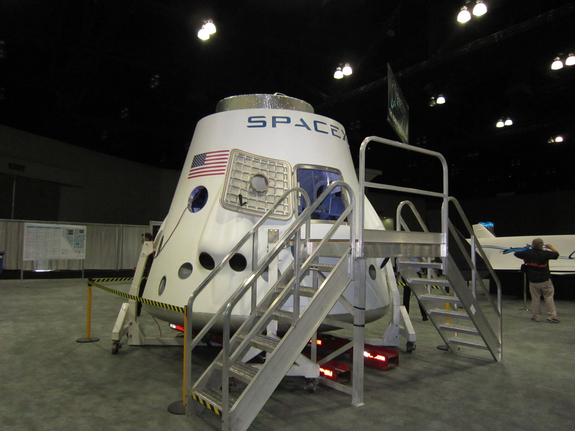 SpaceX displayed their Dragon spacecraft model at the first annual Spacecraft Technology Expo, May 8-10, 2012.