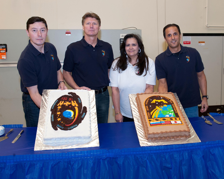 Crewmembers Pose with Cake