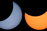 The color of the solar image will depend on the type of solar filter used. Metal-coated glass and black polymer filters produce a pleasing yellow or orange image of the sun, while aluminized Mylar filters show a bluish sun. Welder's No. 14 glass filters give a greenish image (not shown).