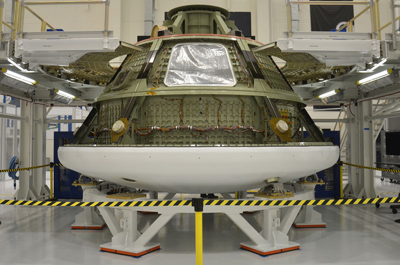Ground test version of the Orion multi-purpose crew vehicle (MPCV) inside the Operations and Checkout (O&C) building at NASA's Kennedy Space Center in Florida. The capsule is being used to ready the facility for the arrival of the first MPCV that will fly into space.