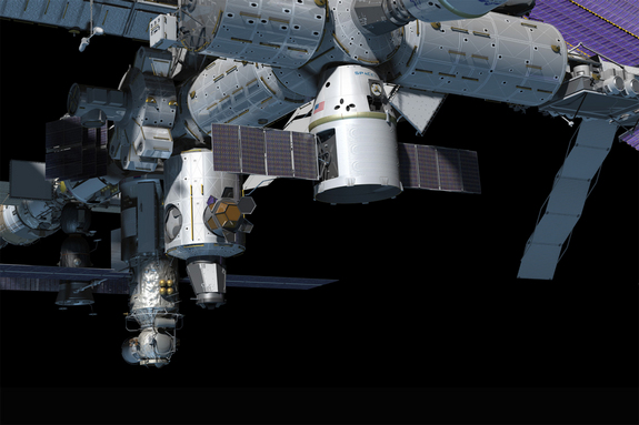 A still from an animated video shows an artist's impression of SpaceX's Dragon capsule at the International Space Station.