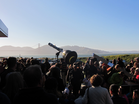 "A ""sun gun"" shows an image of the partial solar eclipse of May 20, 2012 in San Francisco as the Golden Gate Bridge looms in the background."