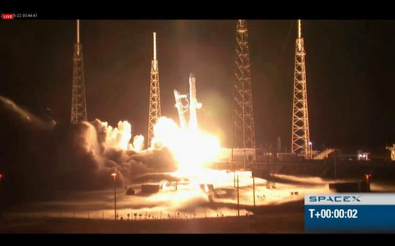 SpaceX's Falcon 9 rocket launches the unmanned Dragon capsule into orbit on May 22, 2012.