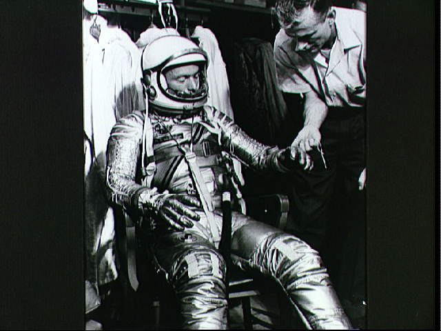 Astronaut Scott Carpenter and Technician Joe Schmidt During Suiting Exercise