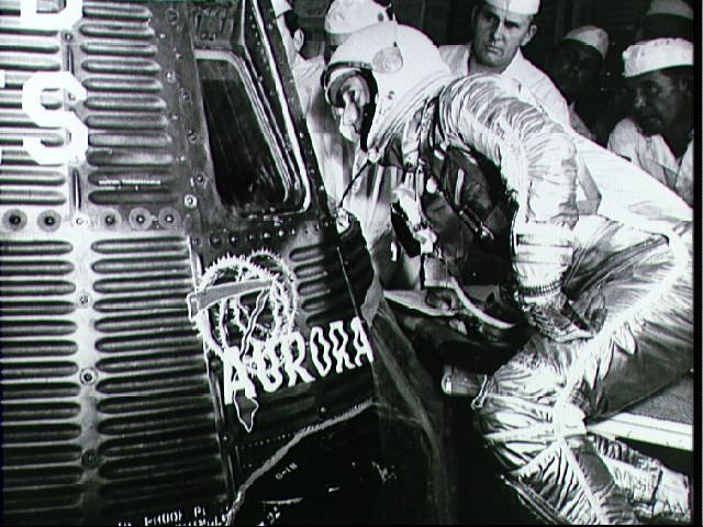 Astronaut Scott Carpenter Looks into Aurora 7 Capsule